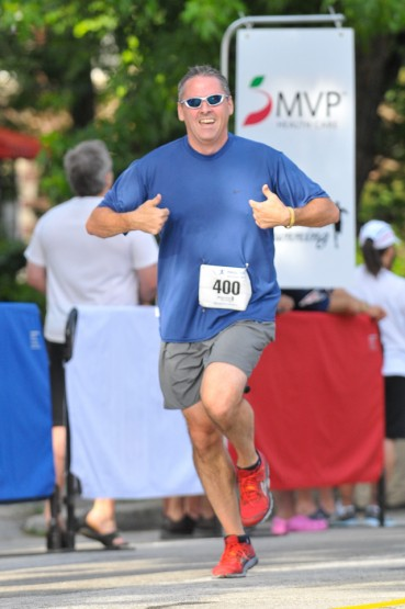 Happy runner at the HASLAW Manchester mile in New Hampshire