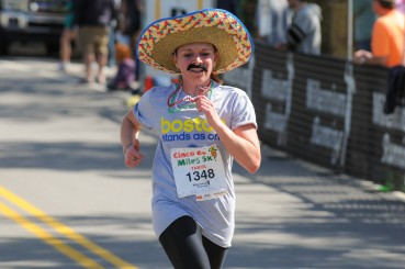 Girl running Cinco de Miles