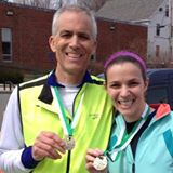 Caryl Pawlusiak abd her dad after completing the Great Bay Half Marathon.