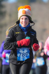 Woman running in road race in bedford, nh for Millennium Running